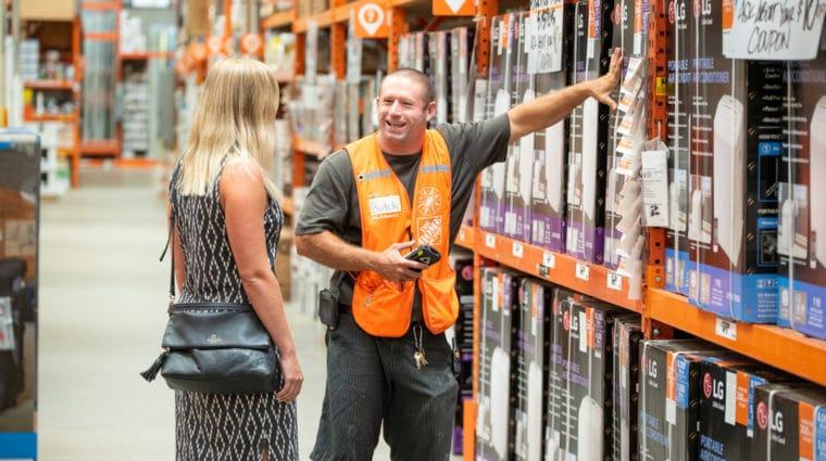 Hardware store employee helping a customer
