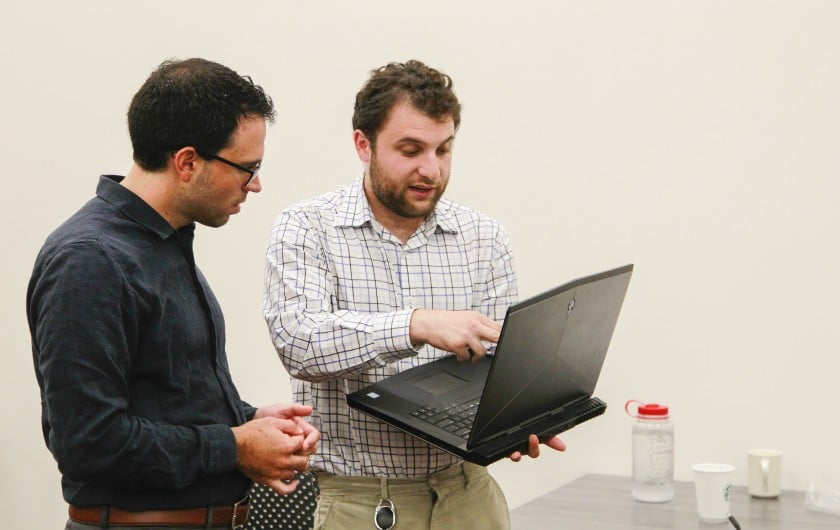 Joseph Riddle, left, director of Neurodiversity in the Workplace, works with David Chidester, 22, on a project